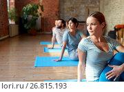 Купить «group of people doing yoga exercises at studio», фото № 26815193, снято 5 марта 2017 г. (c) Syda Productions / Фотобанк Лори