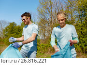 Купить «volunteers with garbage bags cleaning park area», фото № 26816221, снято 7 мая 2016 г. (c) Syda Productions / Фотобанк Лори