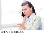 Купить «woman shouting into smartphone», фото № 26816285, снято 1 июня 2013 г. (c) Syda Productions / Фотобанк Лори