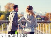 Купить «happy couple running outdoors», фото № 26816293, снято 17 октября 2015 г. (c) Syda Productions / Фотобанк Лори