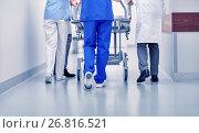 Купить «medics carrying hospital gurney to emergency room», фото № 26816521, снято 3 декабря 2015 г. (c) Syda Productions / Фотобанк Лори