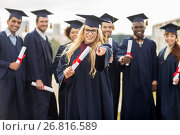 Купить «happy student with diploma pointing finger at you», фото № 26816589, снято 24 сентября 2016 г. (c) Syda Productions / Фотобанк Лори