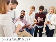happy business team drinking coffee at office. Стоковое фото, фотограф Syda Productions / Фотобанк Лори