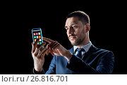 Купить «businessman with transparent smartphone», фото № 26816701, снято 9 марта 2017 г. (c) Syda Productions / Фотобанк Лори