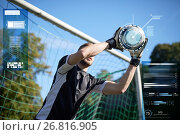 Купить «goalkeeper with ball at football goal on field», фото № 26816905, снято 18 сентября 2016 г. (c) Syda Productions / Фотобанк Лори