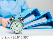 Close-up alarm clock and business documents out of focus. Стоковое фото, фотограф Константин Лабунский / Фотобанк Лори