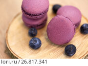 Купить «blueberry macarons on wooden stand», фото № 26817341, снято 8 мая 2017 г. (c) Syda Productions / Фотобанк Лори