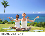 Купить «couple doing yoga in lotus pose outdoors», фото № 26817481, снято 6 августа 2014 г. (c) Syda Productions / Фотобанк Лори