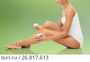 Купить «woman applying moisturizing cream to her leg», фото № 26817613, снято 9 апреля 2017 г. (c) Syda Productions / Фотобанк Лори