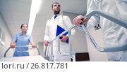 Купить «medics carrying hospital gurney to emergency», фото № 26817781, снято 3 декабря 2015 г. (c) Syda Productions / Фотобанк Лори