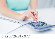 businesswoman working with calculator in office. Стоковое фото, фотограф Syda Productions / Фотобанк Лори