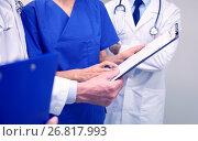 Купить «close up of doctors with clipboard at hospital», фото № 26817993, снято 3 декабря 2015 г. (c) Syda Productions / Фотобанк Лори