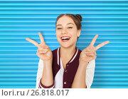 Купить «happy smiling teenage girl showing peace sign», фото № 26818017, снято 19 декабря 2015 г. (c) Syda Productions / Фотобанк Лори