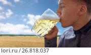 Купить «close up of young man drinking beer from glass mug», фото № 26818037, снято 22 июля 2016 г. (c) Syda Productions / Фотобанк Лори