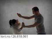Купить «couple having fight and man beating woman», фото № 26818061, снято 20 января 2017 г. (c) Syda Productions / Фотобанк Лори