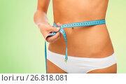 Купить «close up of woman body with measure tape on waist», фото № 26818081, снято 9 апреля 2017 г. (c) Syda Productions / Фотобанк Лори