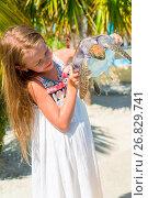 Купить «Adorable little girl with a small turtle in her hands in the natural reserve», фото № 26829741, снято 10 апреля 2017 г. (c) Дмитрий Травников / Фотобанк Лори