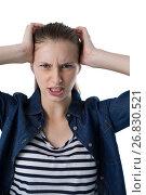Купить «Frustrated teenage girl scratching her head», фото № 26830521, снято 24 января 2017 г. (c) Wavebreak Media / Фотобанк Лори