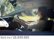Купить «Smiling woman driving a car», фото № 26839065, снято 3 февраля 2017 г. (c) Wavebreak Media / Фотобанк Лори