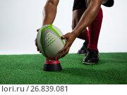 Купить «Low section of sportsman keeping rugby ball on tee», фото № 26839081, снято 26 апреля 2017 г. (c) Wavebreak Media / Фотобанк Лори