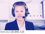 Купить «Portrait of female in black suit which is talking by headset with client», фото № 26845125, снято 6 декабря 2019 г. (c) Яков Филимонов / Фотобанк Лори
