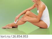 Купить «woman with epilator removing hair on legs», фото № 26854953, снято 9 апреля 2017 г. (c) Syda Productions / Фотобанк Лори