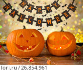 Купить «carved pumpkins and happy halloween garland», фото № 26854961, снято 17 сентября 2014 г. (c) Syda Productions / Фотобанк Лори