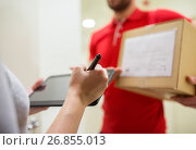 Купить «customer with tablet pc signing for parcel», фото № 26855013, снято 3 декабря 2016 г. (c) Syda Productions / Фотобанк Лори