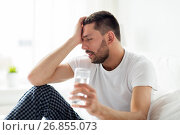 Купить «man in bed with glass of water at home», фото № 26855073, снято 6 мая 2017 г. (c) Syda Productions / Фотобанк Лори