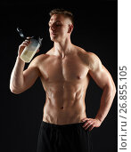Купить «young man or bodybuilder with protein shake bottle», фото № 26855105, снято 2 июля 2017 г. (c) Syda Productions / Фотобанк Лори