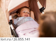 Купить «little child or baby lying in stroller outdoors», фото № 26855141, снято 28 июля 2017 г. (c) Syda Productions / Фотобанк Лори