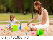 Купить «happy mother and baby girl playing in sandbox», фото № 26855145, снято 28 июля 2017 г. (c) Syda Productions / Фотобанк Лори