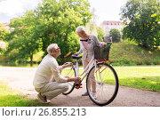 Купить «happy senior couple with bicycle at summer park», фото № 26855213, снято 9 августа 2017 г. (c) Syda Productions / Фотобанк Лори