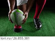 Купить «Close up of of sportsman keeping rugby ball on tee», фото № 26855381, снято 26 апреля 2017 г. (c) Wavebreak Media / Фотобанк Лори