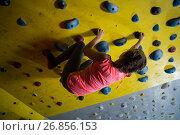 Купить «Teenage girl practicing rock climbing», фото № 26856153, снято 10 мая 2017 г. (c) Wavebreak Media / Фотобанк Лори