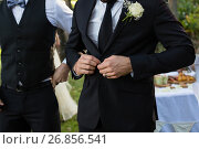 Купить «Bridegroom buttoning a wedding suit», фото № 26856541, снято 2 мая 2017 г. (c) Wavebreak Media / Фотобанк Лори