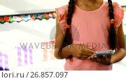 Купить «Schoolgirl holding mobile phone in classroom 4k», видеоролик № 26857097, снято 10 декабря 2018 г. (c) Wavebreak Media / Фотобанк Лори