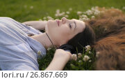 Купить «Woman relaxing while listening to music», видеоролик № 26867669, снято 19 августа 2017 г. (c) Илья Шаматура / Фотобанк Лори