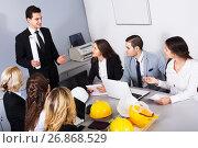 Купить «Team of discussing engineers», фото № 26868529, снято 7 декабря 2019 г. (c) Яков Филимонов / Фотобанк Лори