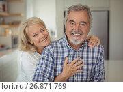 Купить «Senior couple hugging each other at home», фото № 26871769, снято 24 марта 2017 г. (c) Wavebreak Media / Фотобанк Лори