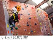 Купить «Determined boy practicing rock climbing», фото № 26873981, снято 10 мая 2017 г. (c) Wavebreak Media / Фотобанк Лори
