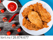 Купить «Bread Crumb Coated Fried Chicken breast, view from above», фото № 26874677, снято 14 июня 2016 г. (c) Oksana Zh / Фотобанк Лори