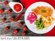 Купить «fried pork chop with french fries, green bean and salad», фото № 26874685, снято 14 июня 2016 г. (c) Oksana Zh / Фотобанк Лори