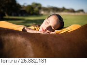 Купить «Female jockey relaxing on horse at barn», фото № 26882181, снято 3 мая 2017 г. (c) Wavebreak Media / Фотобанк Лори
