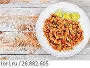 Купить «Sliced Pig Ears marinated with spices, view from above», фото № 26882605, снято 21 августа 2016 г. (c) Oksana Zh / Фотобанк Лори
