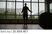 Купить «Muscular man doing rope jump work-out in the gym - silhouette, slow-motion - slider shot», видеоролик № 26884461, снято 20 апреля 2018 г. (c) Константин Шишкин / Фотобанк Лори