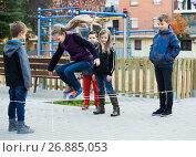 Купить «Friendly kids skipping on jumping elastic rope», фото № 26885053, снято 14 декабря 2017 г. (c) Яков Филимонов / Фотобанк Лори