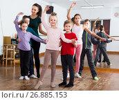 Купить «diligent little boys and girls dancing pair dance», фото № 26885153, снято 12 ноября 2016 г. (c) Яков Филимонов / Фотобанк Лори