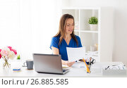 Купить «happy woman with papers and laptop at office», фото № 26885585, снято 22 апреля 2017 г. (c) Syda Productions / Фотобанк Лори