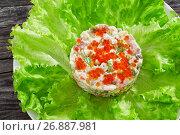 Купить «portion of olivier salad with chopped pickles, sausages and vegetables», фото № 26887981, снято 22 ноября 2018 г. (c) Oksana Zh / Фотобанк Лори